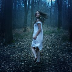 Taken By Rosie Hardy,it was this shot that originally caught my attention ,scared girl running in the woods..white dress,dark lighting