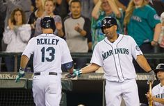 Dustin Ackley of the Seattle Mariners is congratulated by Kendrys...