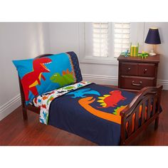 Carter's 4-Pece Toddler Bedding Set - Prehistoric includes:<li>Quilted bedspread</li><li>Fitted bottom sheet</li><li>Flat top sheet</li><li>1 Standard size pillowcase.</li><br><br>Roaring adventures await with dinosaurs! Tyrannosaurus-rex and all his friends, pterodactyl, stegosaurs and triceratops.</br><br>Dinosaur colours are navy, orange, red, bright blue, white with a pop of yellow. Smaller all-over dinosaur sheet print complements this group.</br><br>Made of soft microfiber fabrics…