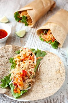 Shredded chicken simmered in a simple sweet chili lime sauce and stuffed inside flatbread wraps with fresh, crunchy veggies. The perfect quick wrap for dinner! | macheesmo.com #wraps #chickenwraps #spicy #sweetchili #easyrecipes #quickmeals