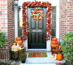 Fall Porch Decorating - like the garland around the door