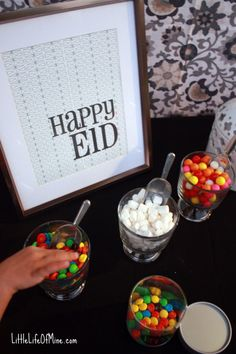 Beautiful Eid Decor!  Same idea for Ramadan - make dates stuffed with coconut, MnMs, nuts and wrap in baking paper. Arrange in a nice jar and put on the table.