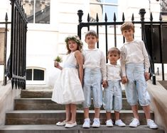 These elegant page boys are wearing our Edward knickerbockers with matching cummerbunds in the most delicate green shade with ivory cotton peter pan shirts.The flower girl is wearing our Grace dress with matching sash. http://www.suehillchildrenswear.com/flower-girls-holy-communion-page-boys.html