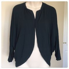 "♣️ Zara basic t-shirt special edition cardigan This is a Zara special edition cardigan. Size small but will also fit medium. 3/4 sleeve length. Color is navy and made of modal. No flaws worn once.   All items are from a clean, smoke free home  We ❤️ offers but will only be considered by using the ""OFFER"" option  Trades  Modeling Zara Sweaters Cardigans"