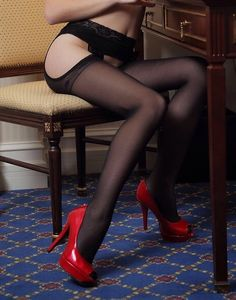 Suspender tights and red high heels