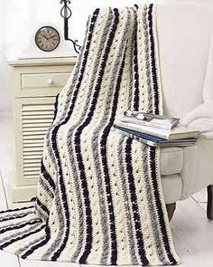 Treble Cross Afghan (Crochet).  Pretty in black, white, and purple?  Or blue, brown, and white?  Either way!