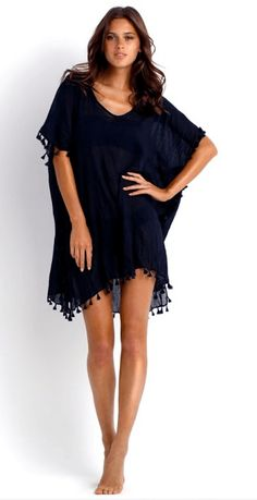 Classic pom pom trim beach cover up in weightless cotton gauze. Seafolly's tassel kaftan is the ultimate essential cover up for your beach vacation. Choose from White, china blue or black. One Size. G