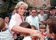 August 10, 1997: Diana, Princess of Wales meets children in an area of Sarajevo where this morning she met more land mine victims during her two day visit to Bosnia. Picture by Stefan Rousseau/PA.