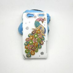 Handmade hard case for DROID RAZR XT917: Bling peacock (customized are welcome). $24.99, via Etsy.