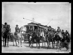 "Twenty five ""ladies riding astride"" participanting in a procession to the Prospect Oval for a carnival in aid of the Australian Soldiers Repatriation Fund. They are gathered in front of a tram. The Register newspaper of 20 November 1916 reported ""Punctually at 2 o'clock a long procession moved away from the North Road, along"