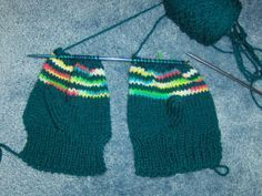 Easy mittens for child sizes knit on two needles... free pattern from Bev's Country Cottage