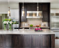 dark cabinets light wood floor, light countertop. Just add white upper cabinets....