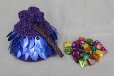 Hey, I found this really awesome Etsy listing at https://www.etsy.com/listing/477653668/scalemail-crocheted-dice-bag-purple