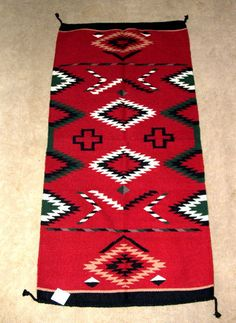 """A colorful wool weaving in classic Navajo design. 32x64"""" w/ tassled corners. Durable for everyday traffic. Pretty enough to hang on your wall as a decorative tapestry! $79.95  (not made by Native Americans) #rug #throwrug #homedecor #southwestern"""