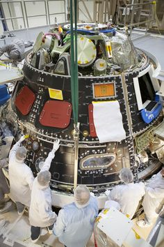 Inside the Operations and Checkout Building high bay at NASA's Kennedy Space Center in Florida, technicians dressed in clean-roo Cosmos, Space Tourism, Space Travel, Space Launch System, Orion Spacecraft, Nasa Images, Nasa Photos, Nasa Space Program, Nasa Missions