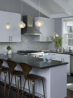 Modern Kitchen Designs. Would rather have white leather chairs but still pretty!