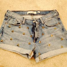 Cut up some old jeans! High-waisted shorts and studded. :)