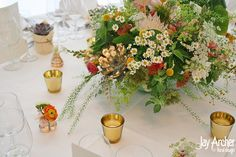 Painted terracota pots with an abundant mix of Summer flowers including gold leafed succulents