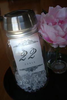 A lit mason jar centerpiece
