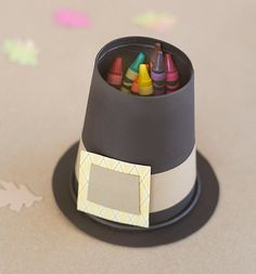 (leprechaun hats too) Pilgrim hats: Cut out the bottom of a black paper cup, hot glue upside-down to a chipboard circle and add a hat band.   plan to try to use a k cup