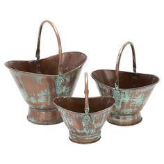 The Arcadian beauty of these metal planters can be found in the traces of verdigris and raised scrolling details that adorn their sides.    ...