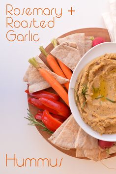 Rosemary and Roasted Garlic Hummus - Delicious 7-ingredient, 10 minute hummus ready for the holiday table. Seasoned with roasted rosemary and garlic, this is a unique hummus. #vegan #vegetarian #gf #sf Zsu's Vegan Pantry