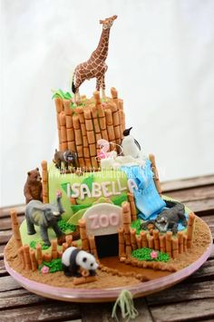 Zoo Birthday 3 tier cake with fondant topping and buttercream filling. Handmade, edible bamboo sticks and scenery decor.