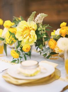 Mixed yellow flower arrangements make a beautiful statement on the table. Southern Wedding/gorgeous yellow blooms by Bows + Arrows Yellow Centerpieces, Wedding Centerpieces, Wedding Table, Rustic Wedding, Floral Wedding, Wedding Decorations, Wedding Ideas, Flower Centrepieces, Modern Centerpieces