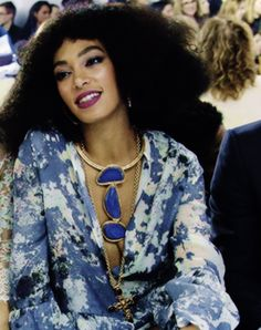 Solange in that dreamy print and necklace.