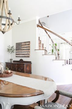 Neutral American flag wall art... Beautiful summer home tour with lots of whites, raw wood tones, and simple summer decorating ideas