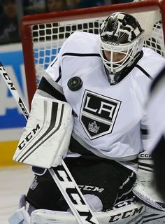 Los Angeles Kings goalie Jhonas Enroth (1) blocks a goal-attempt by the San Jose Sharks during the first period of an NHL hockey game Thursday, Oct. 22, 2015, in San Jose, Calif. (AP Photo/Tony Avelar)