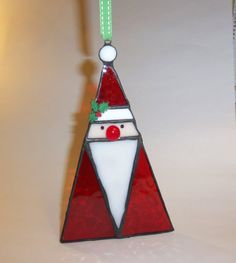 This jolly folk art stained glass Santa ornament measures 7.25 inches tall X4.5 inches wide. This ornament was handmade by me using the Tiffany