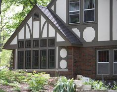 Tudor Revival's decorative half-timber framing is meant to fool the eye—at least in the United States. What is it exactly? A frame of thin boards (often with stucco infilling) is added outside the cladding to mimic medieval construction techniques. Those long-ago structures depended upon heavy timbers to support the weight of the house. The space between those supporting timbers was filled, leaving them visible.