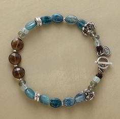 """HEAVENS ABOVE BRACELET--Earth and sky blend of kyanite, aquamarine, moss aquamarine, cognac quartz and sterling beads. Sterling toggle clasp. Handcrafted exclusively for Sundance. 7-1/2""""L."""