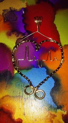 Wire wrap heartbeat pendant