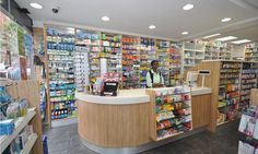 Pharmacy Furniture from the experts ✓ Pharmacy Design Specialists ✓ Evolving Pharmacy Design Display Shelves, Storage Shelves, Small Store Design, Showcase Cabinet, Pharmacy Store, Shelving Solutions, Store Layout, Cosmetic Shop, Clinic Design