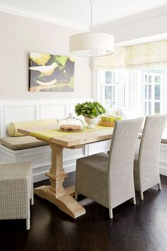 Rattan chairs and a pedestal table complement this small banquette perfect for reading the paper over breakfast or sharing a cup of coffee with friends. Dining Room Banquette, Settee Dining, Dining Table, Pedistal Table, Window Benches, Window Seats, Window Seat Kitchen, Eat In Kitchen, Rattan Chairs