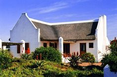 Voorhuis - Voorhuis is a beautiful cottage located in Boggomsbaai, a quaint beach town near Albertinia. It is the ideal spot for a couple's retreat away from the city. The cottage has two bedrooms and a small . Cape Dutch, Good House, Beach Town, Stay The Night, Weekend Getaways, Luxury, Architecture, House Styles, Outdoor Decor