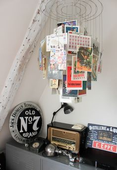 The French love their collections: Here's another Parisian home (as seen on FrenchyFancy), this time with a hanging chandelier made from collected postcards. - HouseBeautiful.com