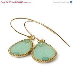 Sale Cyber monday Gold Drops Earrings --  light green resin  dangle earrings Cyber Monday sale. $28.80, via Etsy.