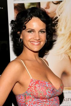 Carla Gugino (born: August 29, 1971, Sarasota, FL, USA) is an American actress. She is known for her roles as Ingrid Cortez in the Spy Kids trilogy, Sally Jupiter in Watchmen, Dr. Vera Gorski in Sucker Punch, and as the lead characters of the television series Karen Sisco and Threshold.