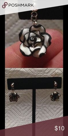 Black and White Rose Stud Earrings These unique earrings are made with black and white clay roses. The earrings are stud earrings and include silver plated backs. All PeaceFrog jewelry items are made by me! PeaceFrog Jewelry Earrings
