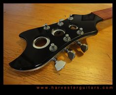 From the Harvester Guitars website. I'm not even joking when I tell you that I have dreams about this headstock.