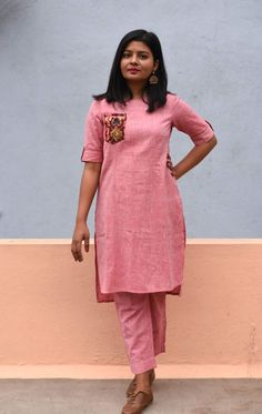 A minimal subtle Khadi cotton tunic with statement pockets, high low hem and sleeve details paired with straight pants. Simple Kurta Designs, Kurta Designs Women, Blouse Designs, Daddy Shirt, Long Dress Design, Hand Work Blouse Design, Indian Fashion Dresses, Cotton Tunics, Woman Clothing