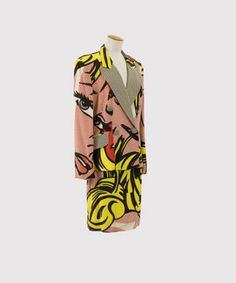 Historical reference: 1950s pop art movement had a great impact on fashion in 50s. This 2 piece suit is made in 1991 inspired by 50s pop artist, Roy Lichtenstein.