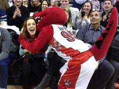 Rachel McAdams gets snuggled by mascot at Toronto Raptors game. http://www.people.com/people/article/0,,20678030,00.html