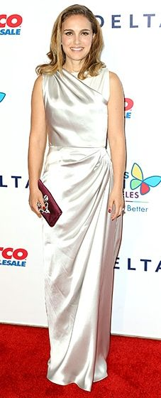 Natalie Portman attended the event in a silk Dior gown featuring gathered ruching along with neck and waistline. A maroon clutch with silver embellishments completed the look.