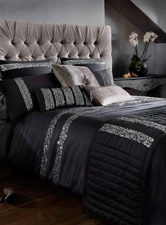 Where can I find this? This sophisticated black satin effect bed linen from Kylie features silver sequin stripes to add a sparkling touch to your bedroom. Upholstered headboard.