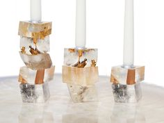 These naturally cube-like Brazilian mineral candlesticks brim with reflective light and luminosity.