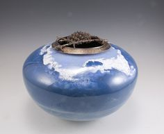 Harlan Butt-- Glacier Vessel #2 2015 copper, enamel, silver 5.5 x 8 x 8 Glacier Vessel #2 reflects the experience of my time spent at Glacier National Park, MT as part of my National Parks Project sponsored by the Institute for the Advancement of the Arts at the University of North Texas.